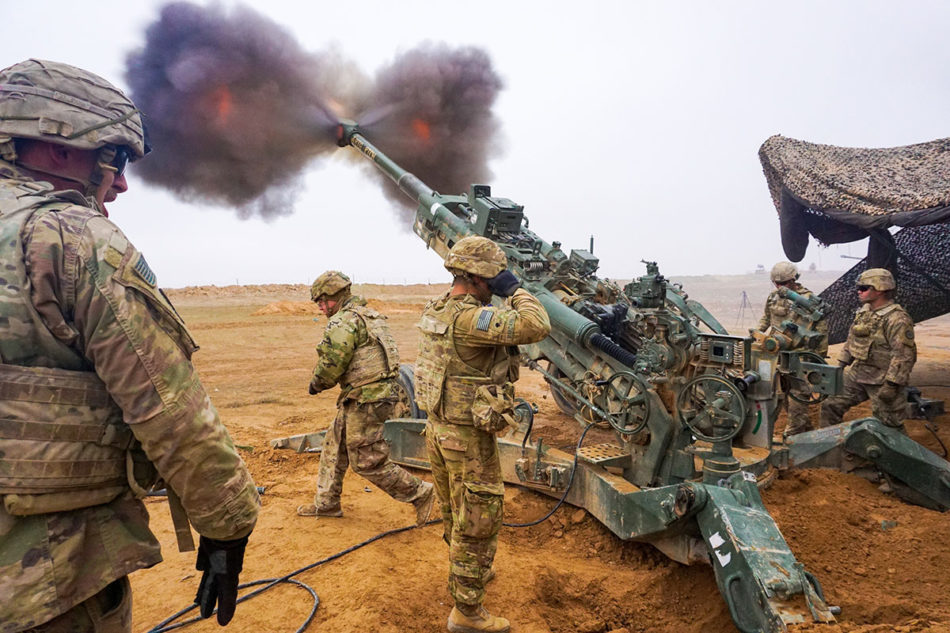 U.S. Army troopers assigned to the Field Artillery Squadron, 3rd Cavalry Regiment, fire their M777 Howitzer on Firebase Saham, Iraq, Dec. 3, 2018. They are deployed in support of Operation Inherent Resolve, working by, with and through the Iraqi Security Forces and Coalition partners to defeat ISIS in designated areas of Iraq and Syria. (U.S. Army photo by Capt. Jason Welch)
