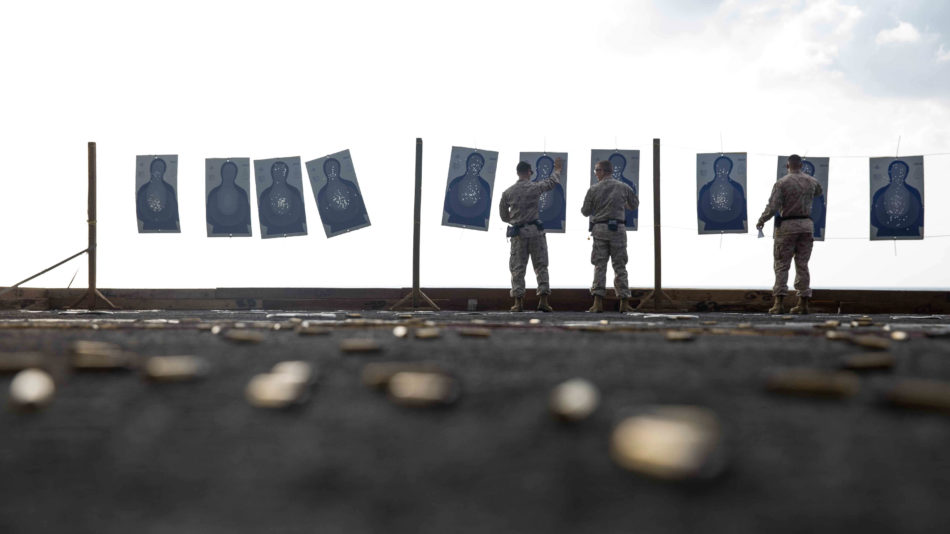 """USS MAKIN ISLAND, Gulf of Aden (Jan. 19, 2017) U.S Marines with Combat Logistics Detachment 111, Combat Logistics Battalion 11, 11th Marine Expeditionary Unit, straiten tilted targets during a live-fire range or """"deck shoot"""" aboard the USS Makin Island (LHD 8), Jan. 19. The range allowed the Marines to practice their marksmanship skills while deployed aboard the USS Makin Island. (ph U.S. Marine Corps/ Cpl. April L. Price)"""