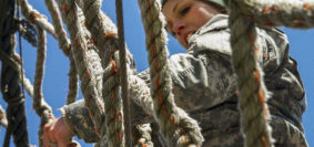 Army Sgt. Amanda Spear descends a rope ladder on the obstacle course for the Indiana National Guard Best Warrior Competition at Camp Atterbury, Ind., March 4, 2017. Spear is assigned to the 638th Aviation Support Battalion. During the event, soldiers needed to demonstrate proficiency in warrior tasks and skills, including marksmanship, emergency first aid and land navigation. Army National Guard photo by Sgt. Evan Myers