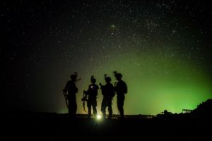 U.S. Army Soldiers from Easy Company, 101st Airborne Division (Air Assault), stand by for their night guard shift in Kenya, Jan. 20, 2020. Soldiers from the 101st Airborne Division are assigned to the East Africa Response Force and provide the ability to rapidly respond to events spanning a vast area of responsibility. (U.S. Air Force photo by Staff Sgt. Shawn White)